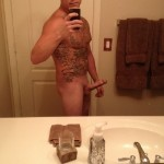 Tattooed Nude Man With Erection